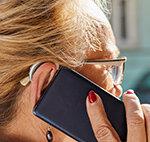 Mit Hörgerät am Handy Meldung